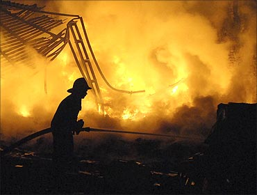 firefighter extinguishes fire from a textile processing unit.