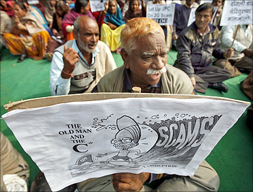 Activists of Communist Party of India Marxist CPI (M) hold a cartoon placard.