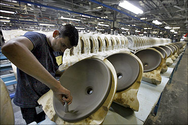An employee works inside the Duravit production site in Gujarat.
