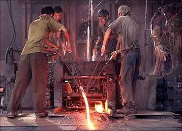 Labourers work inside a steel factory in Siliguri.
