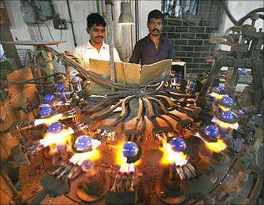 Indian labourers work in a bulb factory in Kolkata.