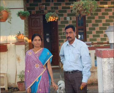 Dnyaneshwar Nivrutti Bodke with his wife at his farm in Hinjewadi.