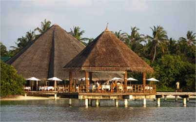 Tourists enjoy their dinner at a restaurant on the island resort of Har Alif Atoll.