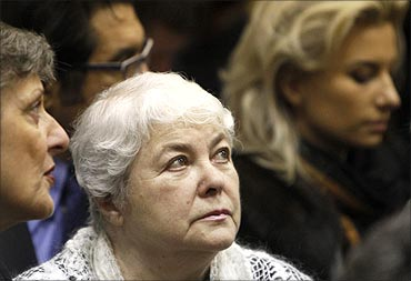 Marina Khodorkovskaya, mother of jailed Russian former oil tycoon Mikhail Khodorkovsky, stands in the courtroom before the start of a court session in Moscow.