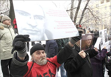 People hold portraits of Mikhail Khodorkovsky during a rally in support of Khodorkovsky.