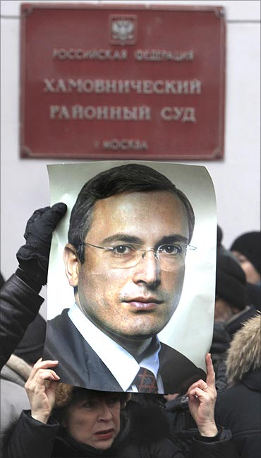A woman holds a portrait of jailed Russian former oil tycoon Mikhail Khodorkovsky during a rally.