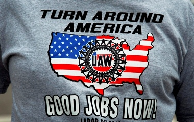 A United Auto Workers union member wears a 'Good Jobs Now' union t-shirt as he marches in the 2010 annual Labor
