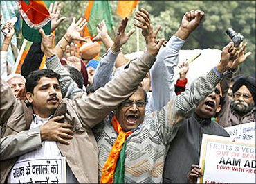 People protesting against price rise in New Delhi.