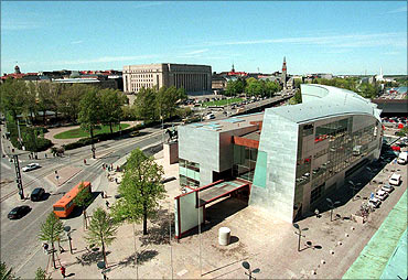 Finland's museum of modern art, 'Kiasma' , in Helsinki with the House of Paliament in the background