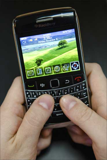 A person poses while using a Blackberry Bold 2 smartphone at the Research in Motion headquarters in Waterloo.