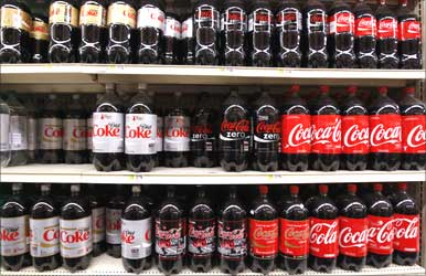 Bottles of Coca Cola on display in a store in New York.