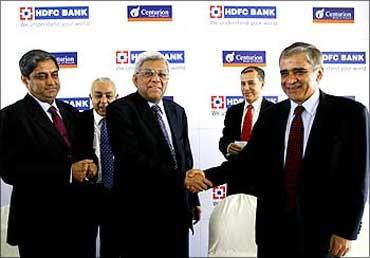 Deepak Parekh, chairman,HDFC Bank, with Rana Talwar, chairman of Centurion Bank of Punjab