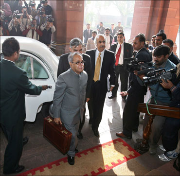 Finance Minister Pranab Mukherjee arrives at Parliament to unveil last year's Budget.