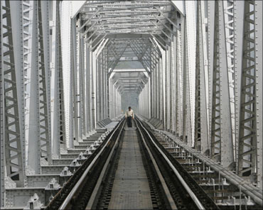 A man crosses a railway bridge on Teesta River near Siliguri.
