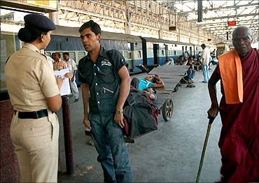 A security personnel checks a passenger.