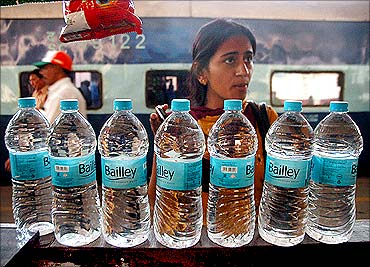 A passenger purchasing bottled water.