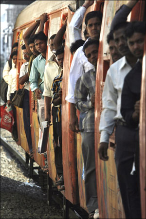 Image: Commuters travel in a suburban train in Mumbai. Photograph: Arko Datta/Reuters