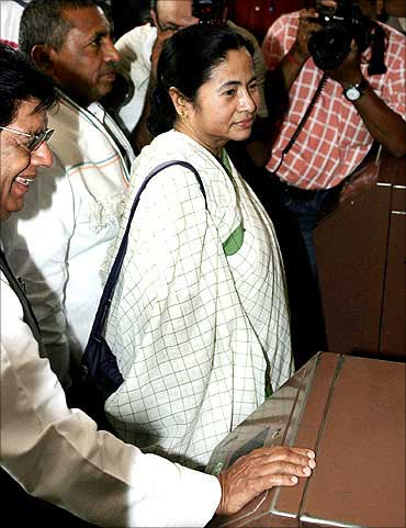 Railway Minister Mamata Banerjee (C) arrives at the Parliament.