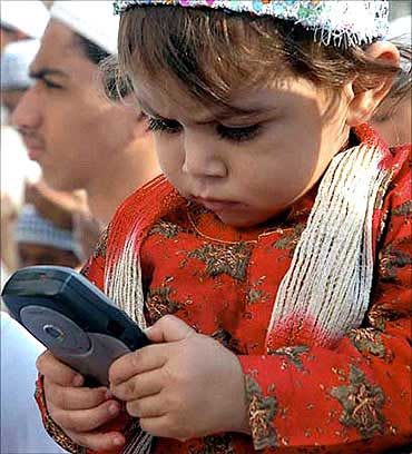 A child playing with a mobile phone.
