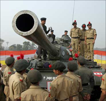 Image: Students from the National Cadet Corps stand on a tank at an exhibition organised by the Indian Army in Siliguri. Photograph: Rupak De Chowdhuri/Reuters
