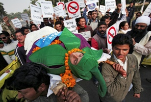 Students hold a mock funeral procession against Bt (Bacillus thuringenesis) brinjal