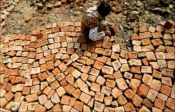 A labourer works at a road construction site in Bihar.