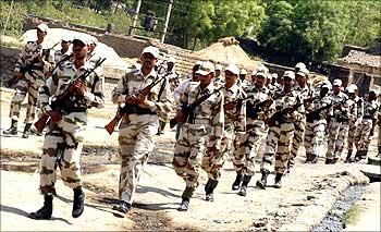 Indo-Tibetan Border Police personnel patrol a road in Jehanabad, Bihar.