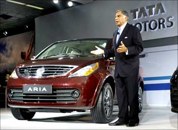 Tata Motors Chairman Ratan Tata speaks during the unveiling ceremony of Tata Motor's new car Aria at India's Auto Expo in New Delhi.