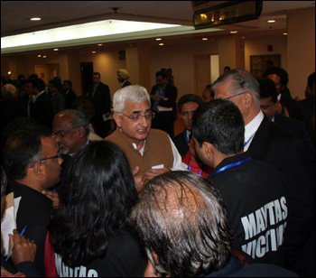 Angry NRIs gheraoing Minister for Corporate and Minority Affairs Salman Khursheed.