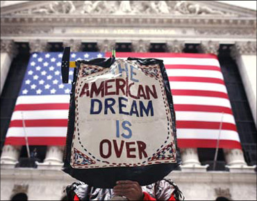 A sign at the NYSE depicting the immigrants' plight.