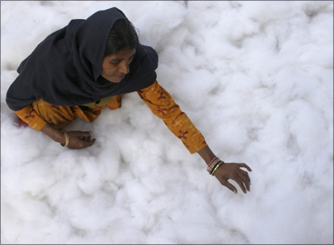 A woman gathers cotton to make a quilt at a workshop in Chandigarh.