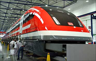 Workers polish a prototype of the new maglev Transrapid high-speed train in the central German city of Kassel.