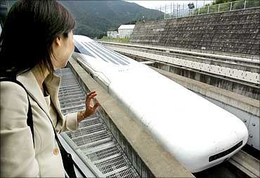 A Japanese woman looks at Central Japan Railway Co.'s Maglev train, which is levitated and propelled by magnetic forces, at an 18.4 kilometre test track of in Tsuru, west of Tokyo.