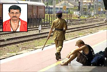 A tourist sits on an empty railway platform in Palakkad.