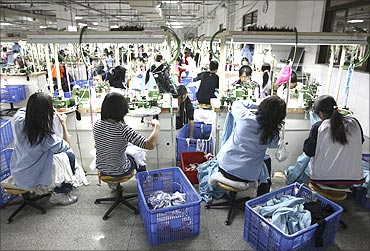 Labourers work at a textile factory in Dongguan, Guangdong province.