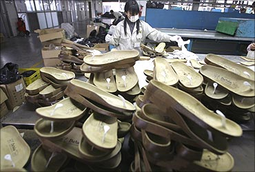 A woman works at a shoe factory in Dongguan, southern China's Guangdong province.