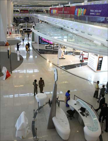 People walk inside the newly constructed Terminal 3 at Indira Gandhi International Airport.