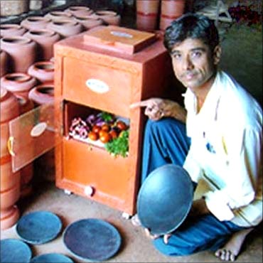 Mansukhbhai Prajapati with his innovation, Mitticool.