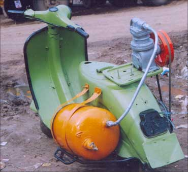 The scooter-powered spray painting device.