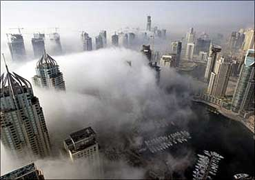Fog rolls by early in the morning, near the Dubai Marina construction and residential zone.