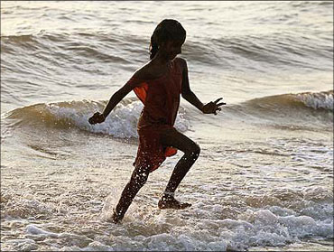 A girl plays at a beach in Chennai, Tamil nadu.