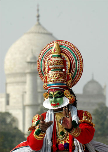 A dancer performs at the rear of the historic Taj Mahal to promote tourism in Agra.