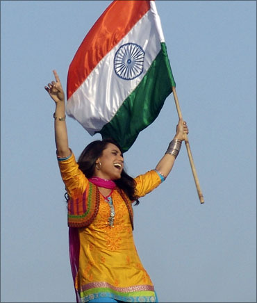 Actress Rani Mukherjee waves the Indian flag.