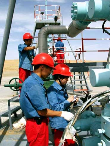 Chinese employees of China National Petroleum Corp. work at Tarim Oil Field.