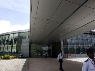 Security guards walk in the SAP India labs campus in Bengaluru.