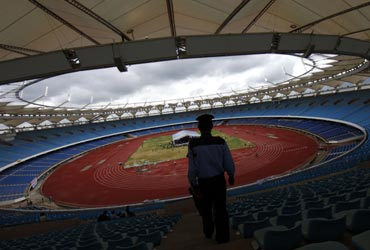 A paramilitary soldier stands guard inside the Jawaharlal Nehru Stadium constructed for the 2010 Commonwealth  in New Delhi.