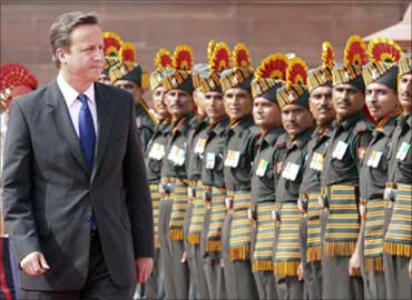 David Cameron inspects a guard of honour during his ceremonial reception at the presidential palace in New Delhi.