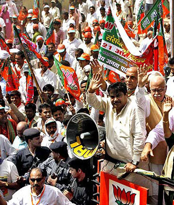 BJP stalwarts Nitin Gadkari, L K Advani and Rajnath Singh leading a rally against price rise.