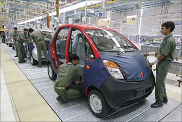 Employees work inside the newly inaugurated plant for the Tata Nano car at Sanand.