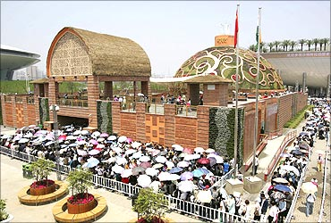 Visitors queue to enter the India Pavilion at the Shanghai World Expo site.